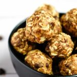 vegan protein balls in a black bowl