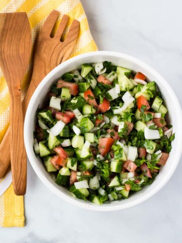 tomato cucumber salad in white bowl