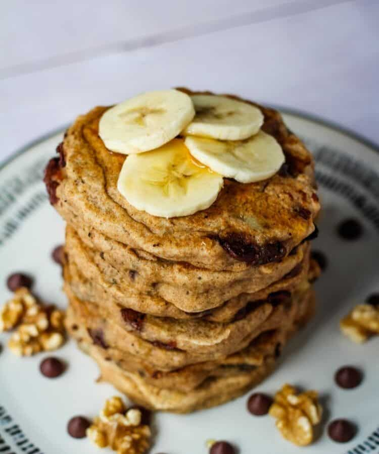 vegan whole wheat pancakes topped with banana slices