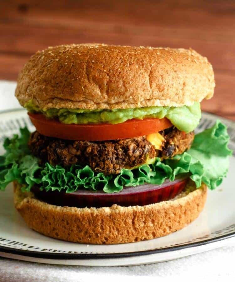 black bean quinoa burger on white plate