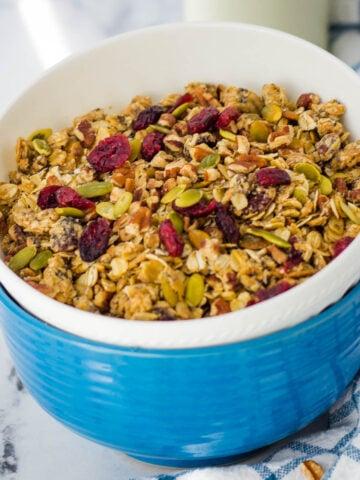 Sugar free granola with cranberries in mason jar.