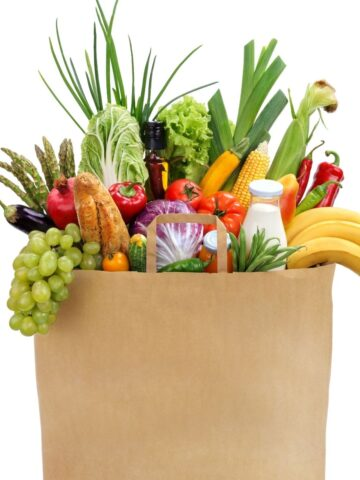 brown bag of groceries willed with fresh fruits, and vegetables