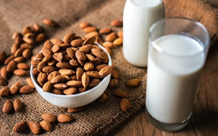 almond milk and bowl of almonds