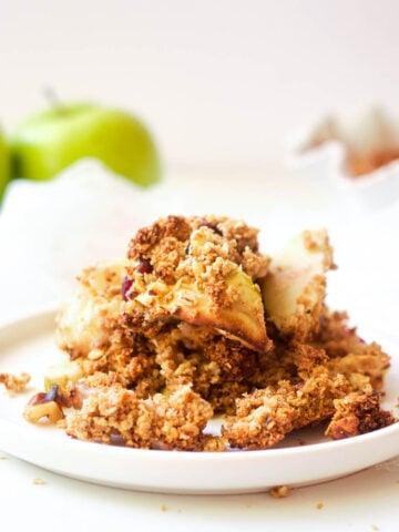 sugar free apple crisp in a bowl with coconut ice cream