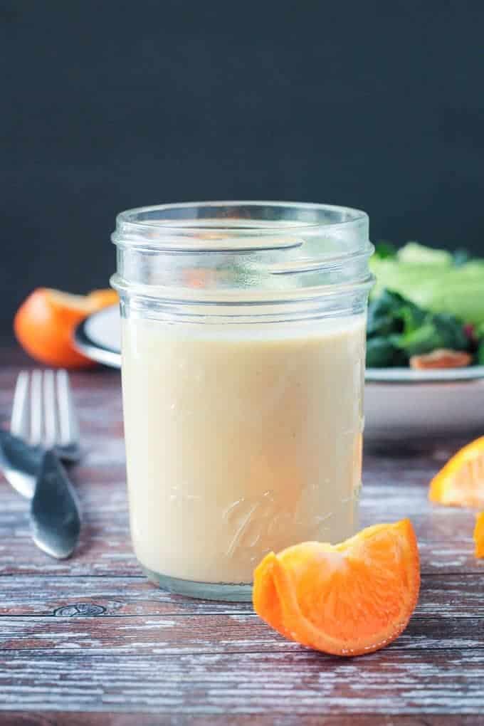 vegan salad dressing: citrus tahini dressing in glass jar