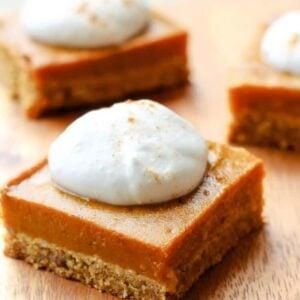 vegan gluten-free pumpkin pie bar with coconut whipped cream