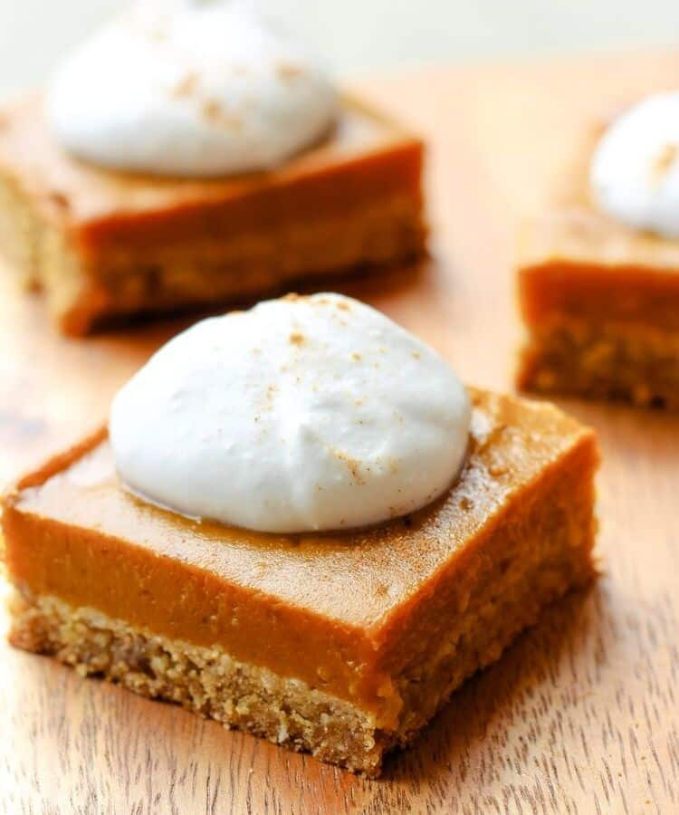 vegan gluten-free pumpkin pie bar with coconut whipped cream
