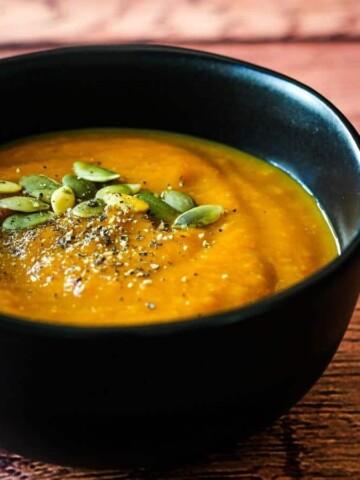 vegan pumpkin soup in black bowl