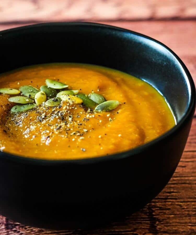 vegan pumpkin soup in black bowl