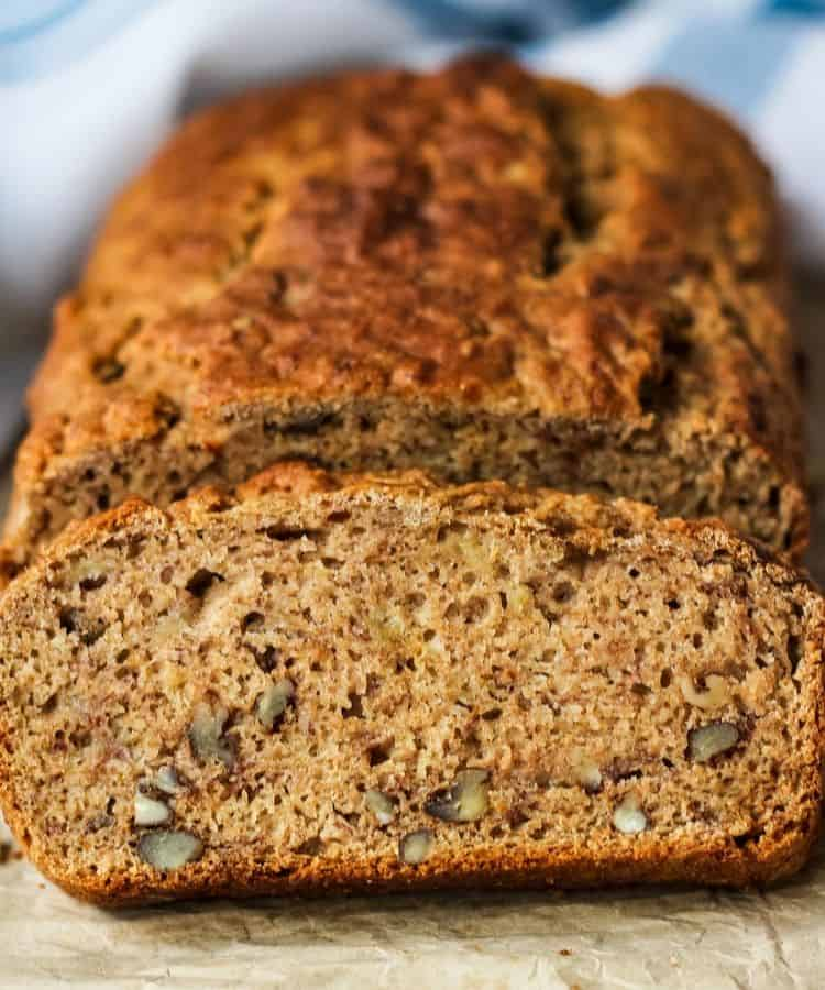 straight on close up of dairy free banana bread loaf and slice