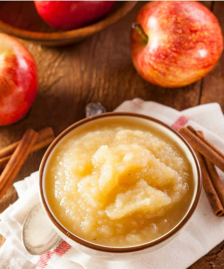 sugar free applesauce in a bowl with apples, and cinnamon