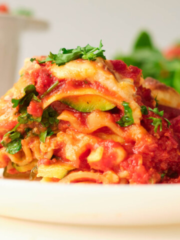 layers of gluten-free vegan lasagna on white plate