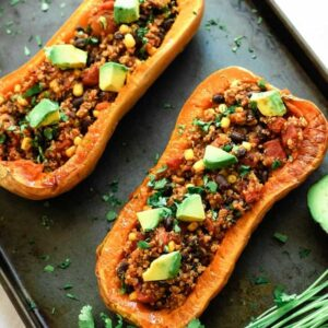 vegan stuffed butternut squash on baking sheet