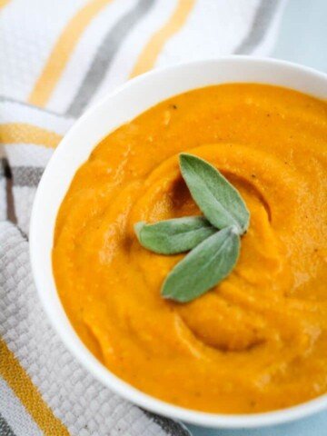 vegan butternut squash soup with sage leaves