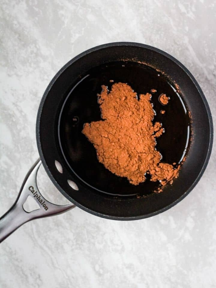 cocoa powder and coconut oil in pan
