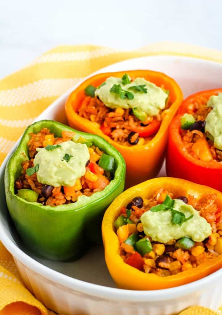 vegan stuffed peppers topped with avocado cream