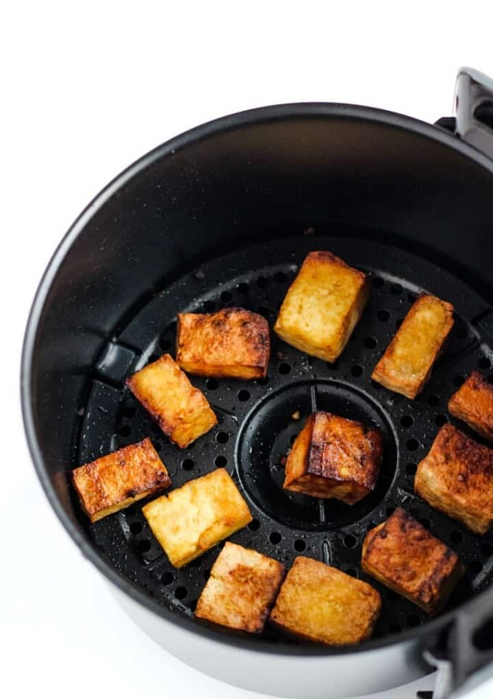 air fryer tofu in basket after it's cooked