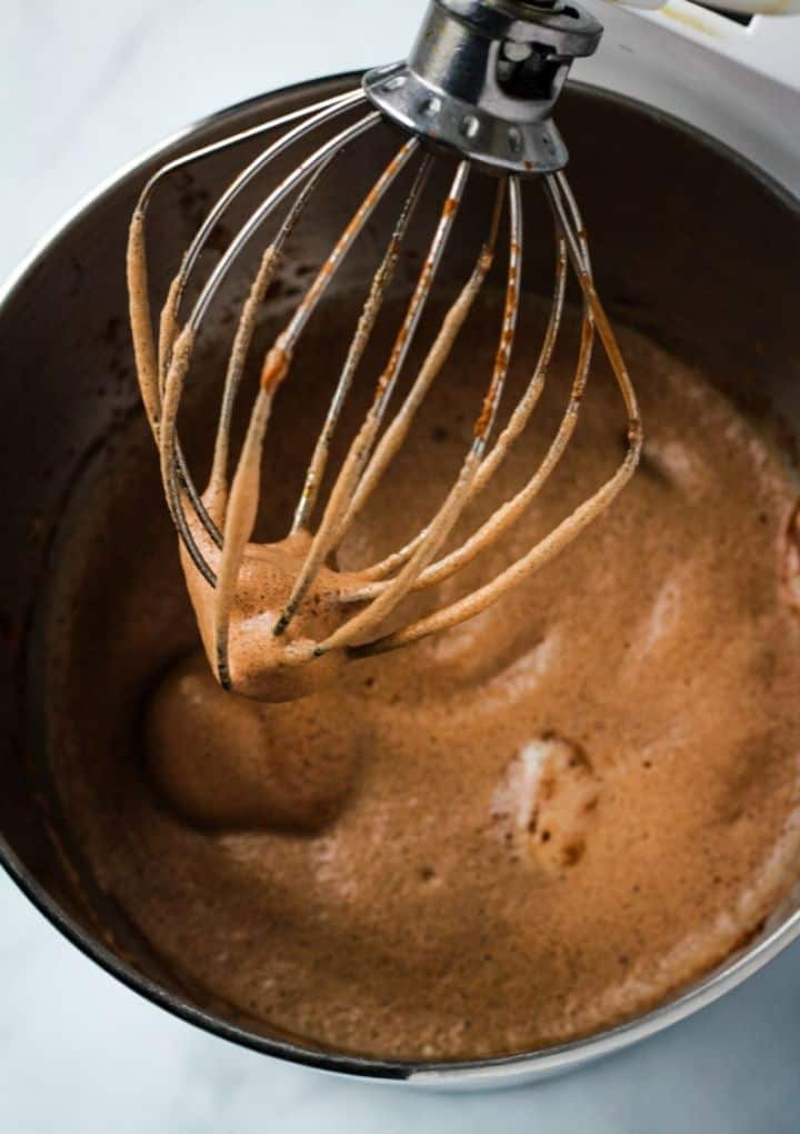 Aquafaba and cocoa powder whipped in mixer with whisk attachment