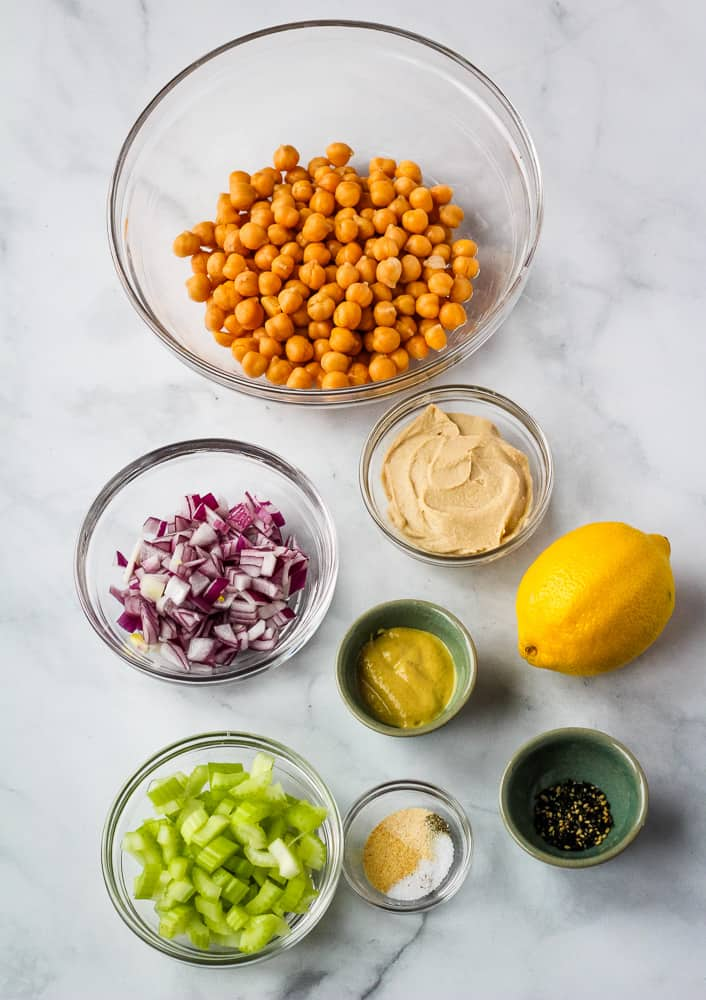 chickpeas celery, onions, lemon, hummus, and spices  in bowls