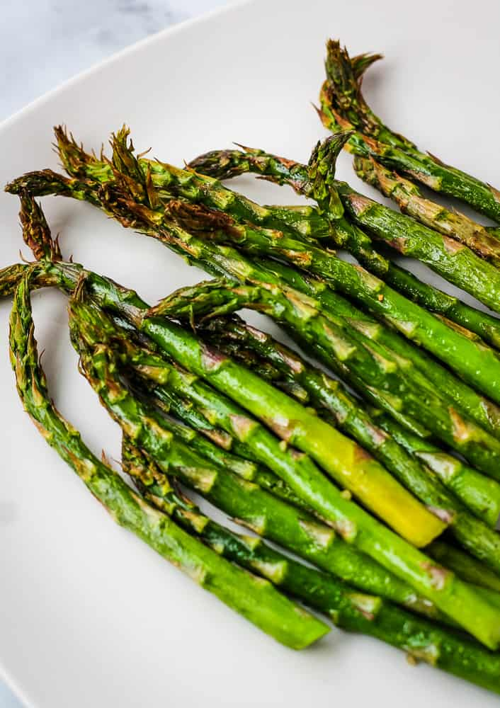 air fryer asparagus on white plate