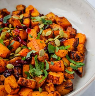 squash topped with parsley and cranberries