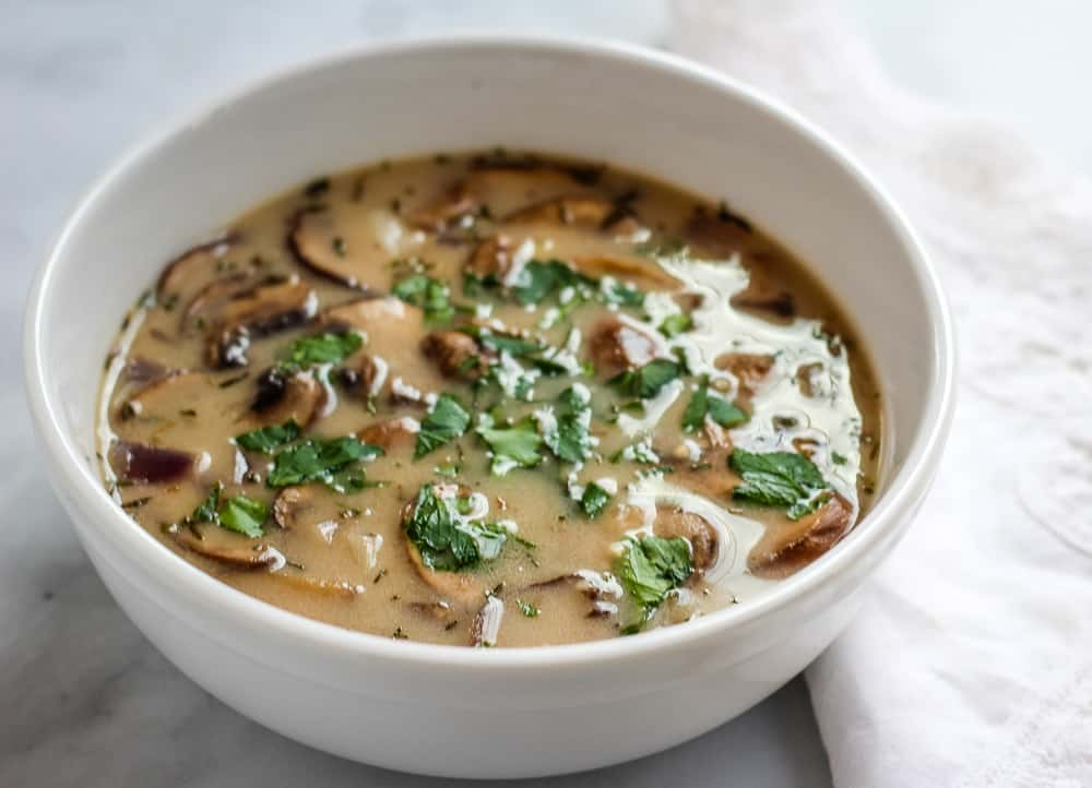 close up vegan mushroom soup with parsley