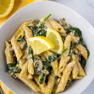 vegan mushroom pasta in white bowl