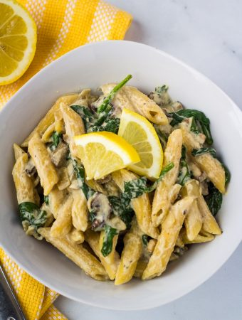 vegan mushroom pasta in white bowl