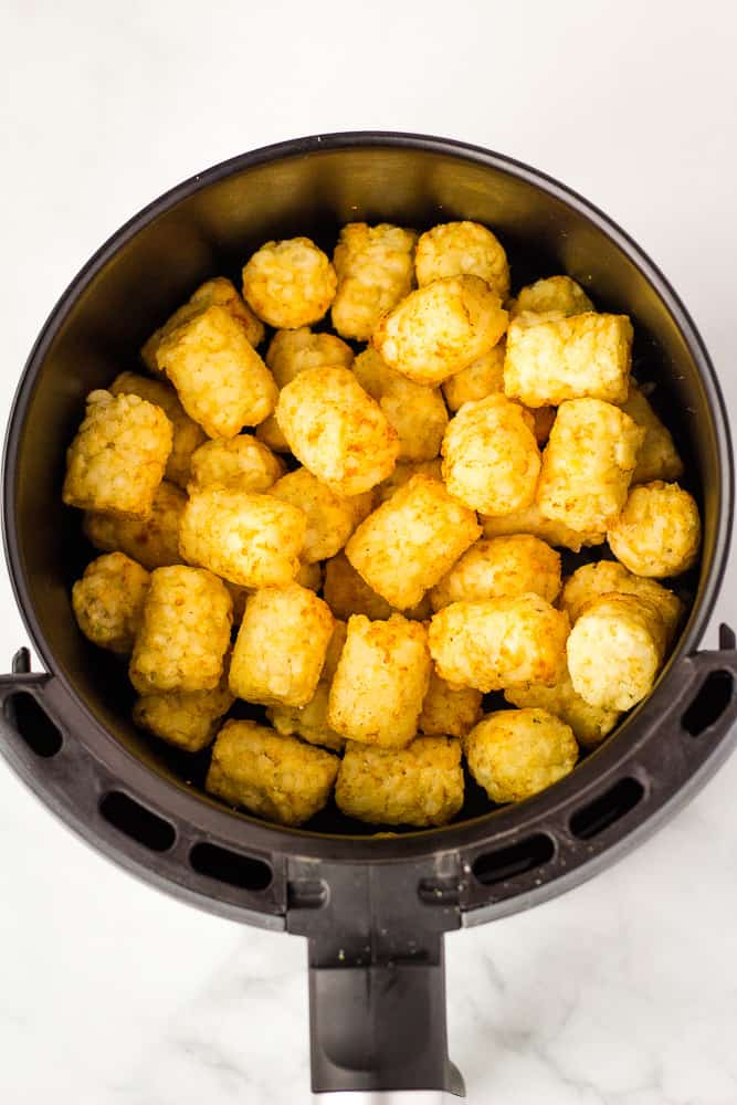 air fryer basket filled with tater tots