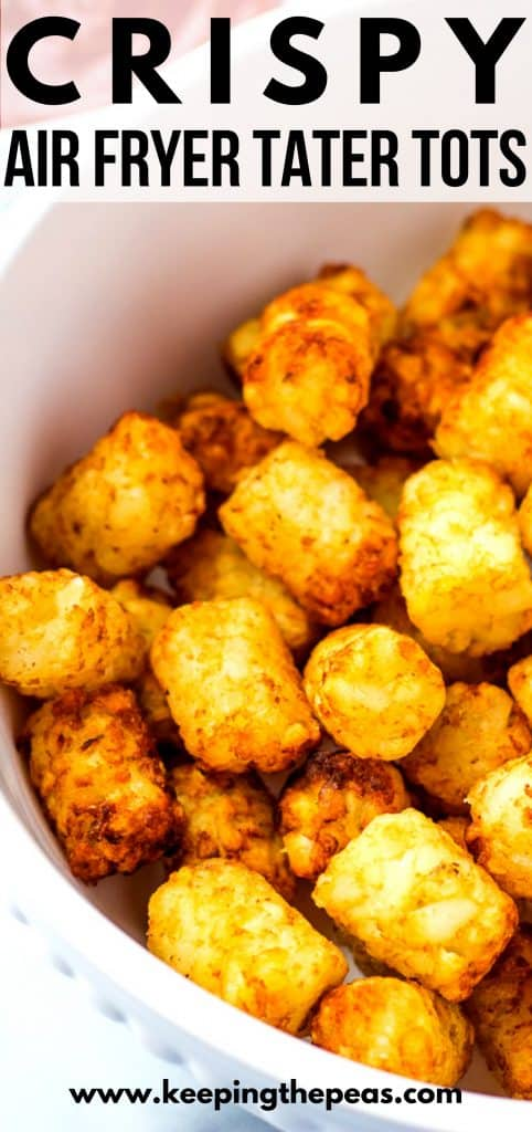 Crispy golden brown tater tots in white bowl.