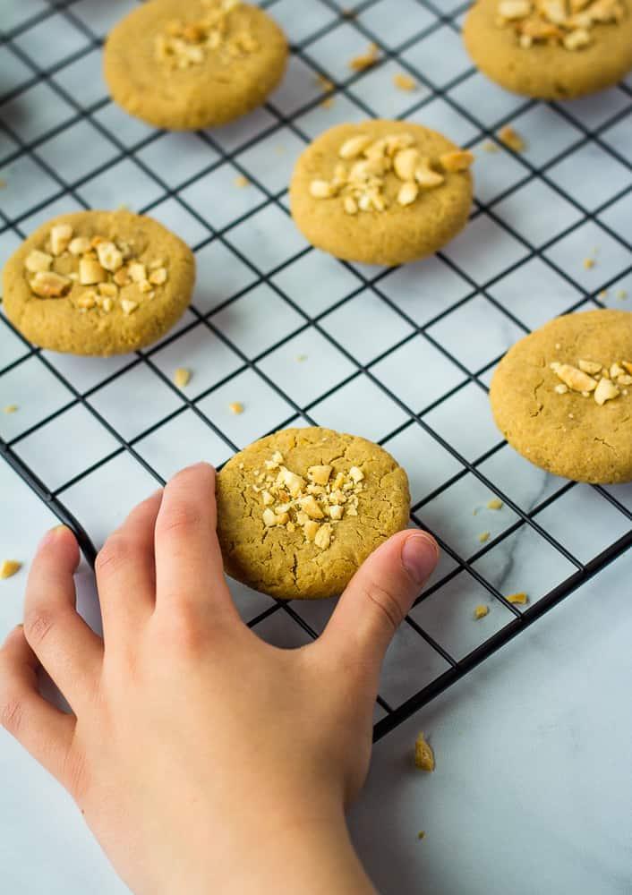 hand grabbing cookie