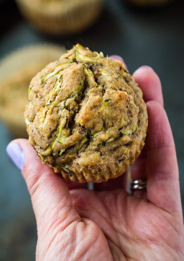 hand holding zucchini muffin