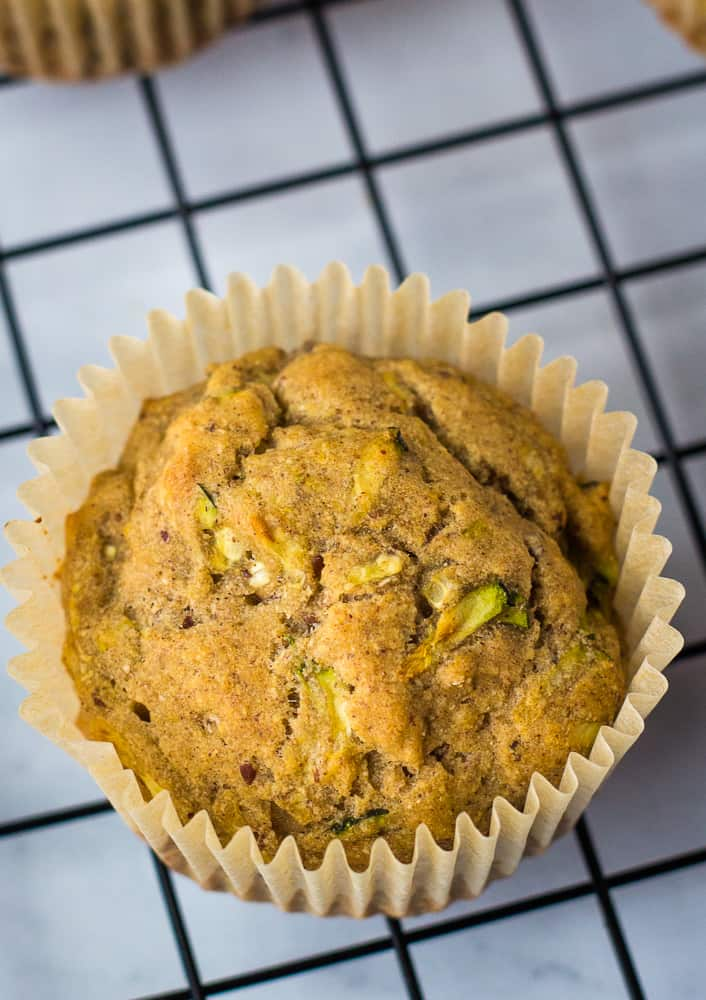 vegan zucchini muffin on cooling rack