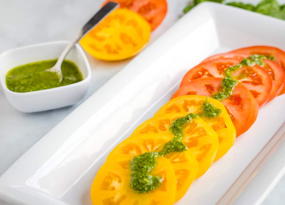 heirloom tomatoes with basil sauce over top