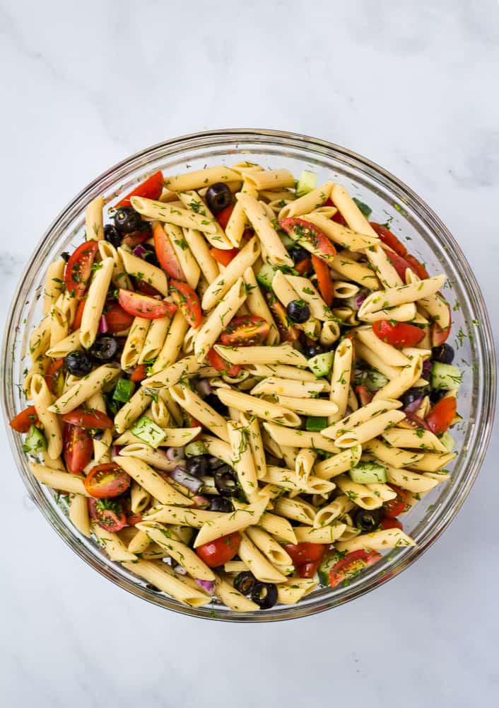 overhead large bowl of pasta salad in glass bowl