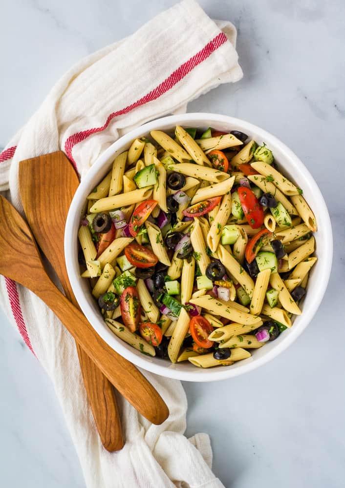 gluten free pasta salad in white bowl