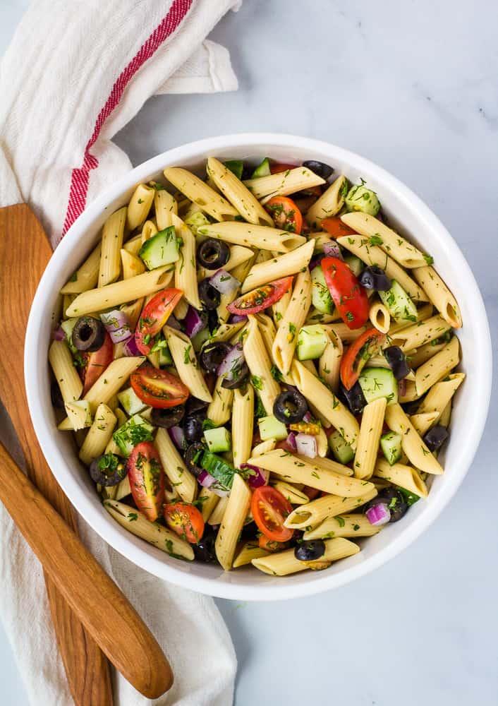 overhead of gluten free pasta salad in white bowl