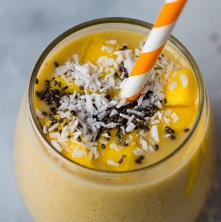 closeup of mango smoothie topped with chia seeds