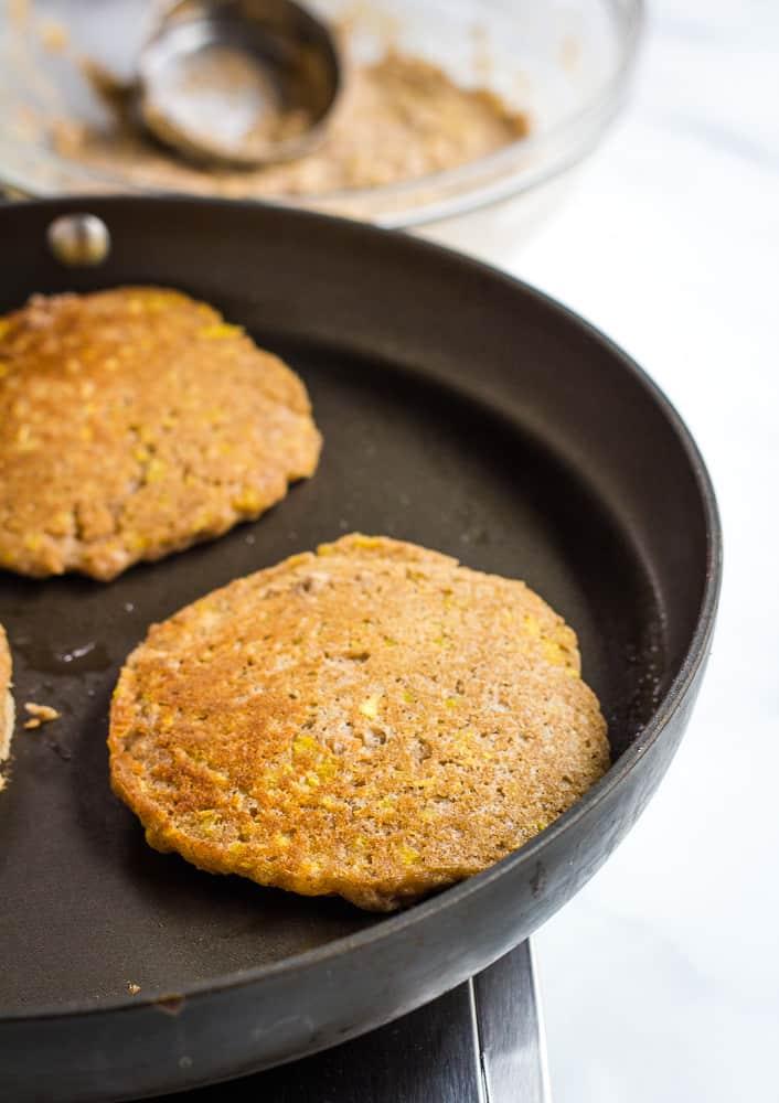 mango pancakes on skillet