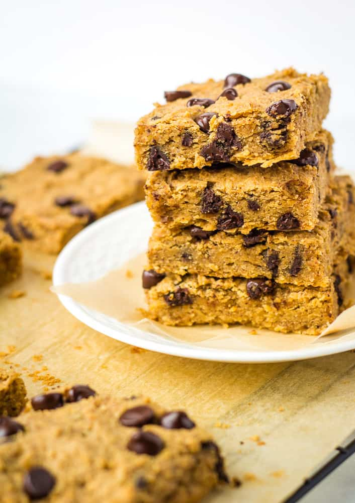 stack of 4 vegan blondies on white plate