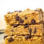stack of 3 vegan blondies on parchment paper