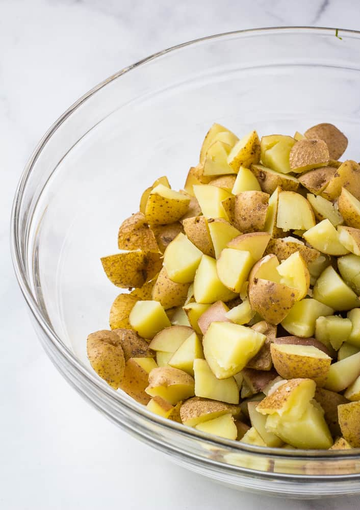 cubed potatoes in glass bowl