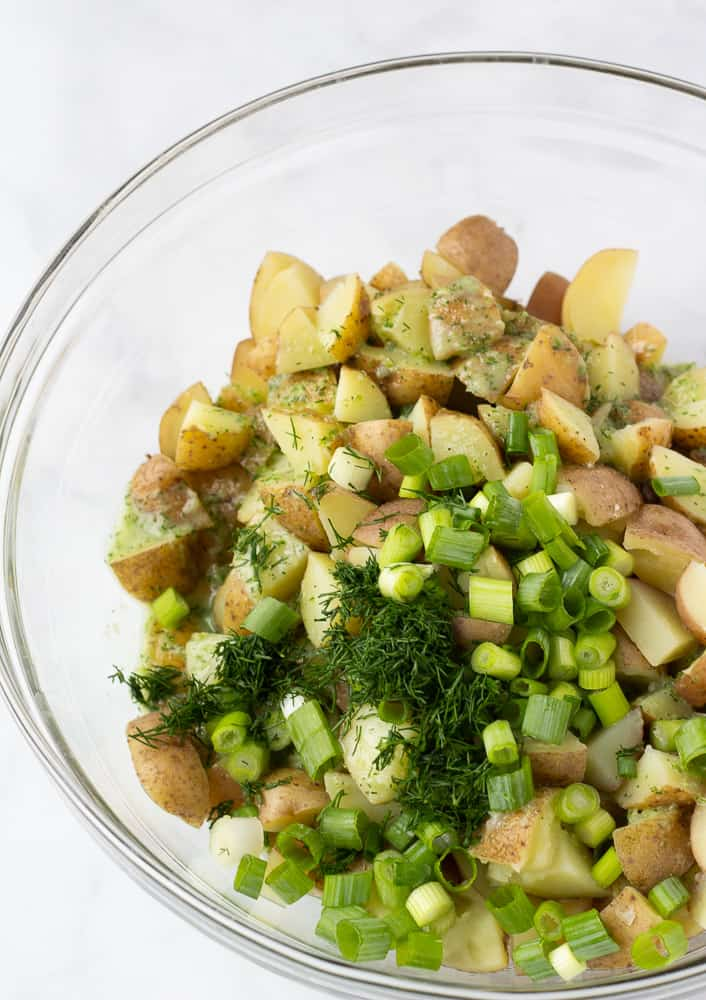 potatoes topped with fresh herbs and dressing