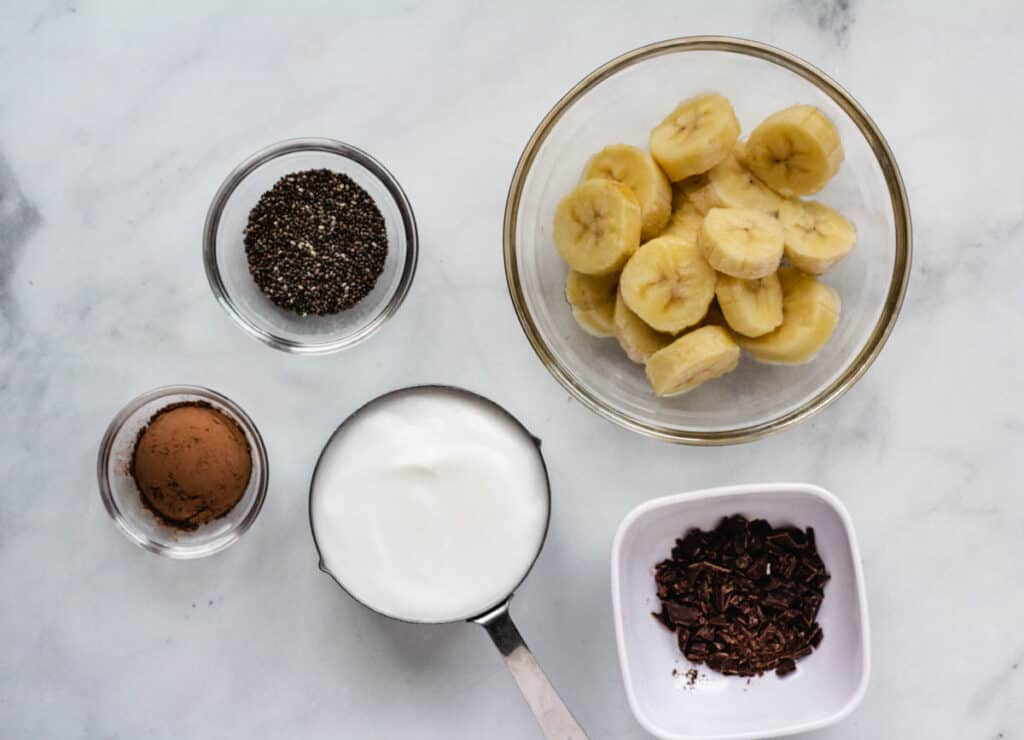 chopped banana, yogurt, chocolate and chia seeds in bowls