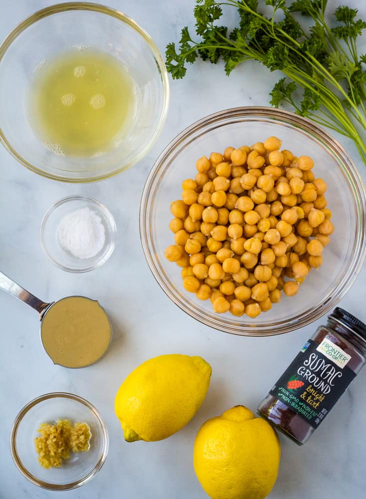 lemons, tahini, chickpeas, garlic, parsley, aquafaba, sumac