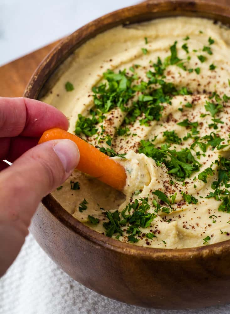 carrot dipped in hummus