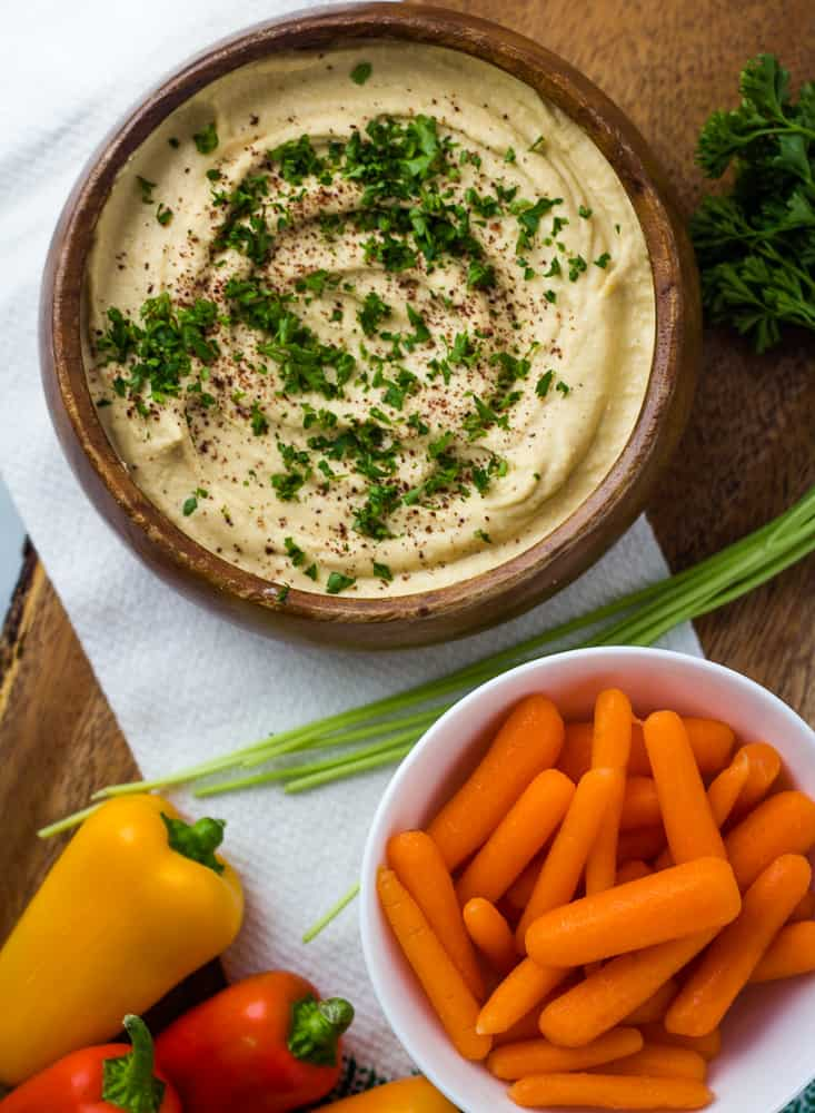hummus spread with carrots and peppers