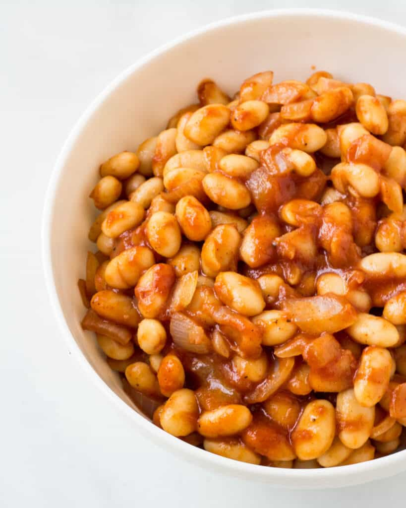 baked beans in white bowl