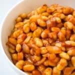 baked beans in white bowl