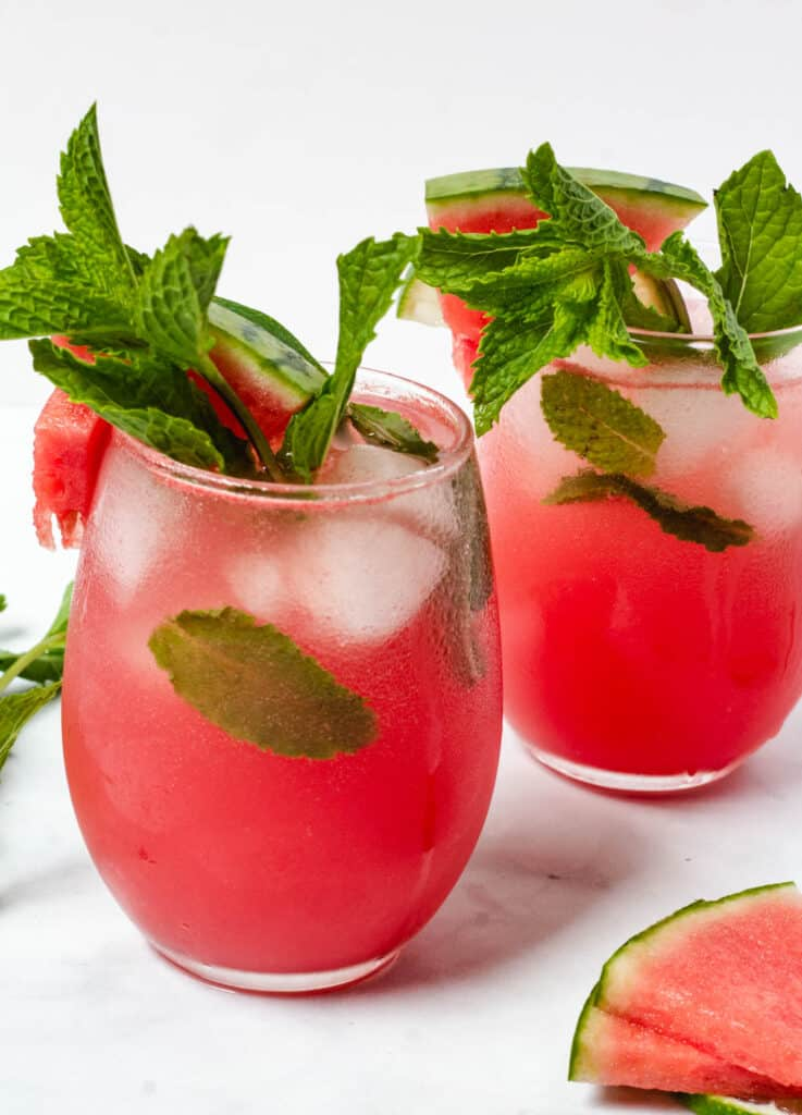 two glasses of garnished watermelon drinks